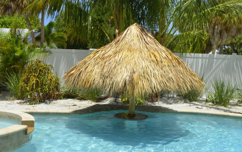 Swim up tables tiki tops beach monkey pools for Swimming pools with built in tables
